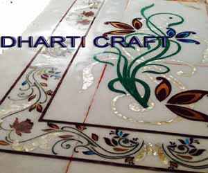Design work on marble by hand called Marble Carpet Inlay design to make it feel luxury for flooring